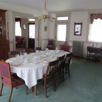 A table set for 8 in the dining room